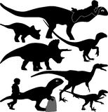 Dinosaur and kid silhouette  Royalty Free Stock Photo