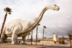Dinosaur. A large Brontosaurus Dinosaur against a cloudy sky Royalty Free Stock Photos