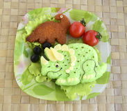 The dinosaur is made of rice. Kyaraben, bento Stock Photo