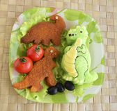 The dinosaur is made of rice. Kyaraben, bento Stock Photography
