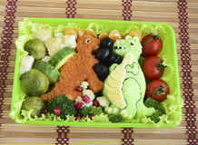 The dinosaur is made of rice. Kyaraben, bento Stock Image