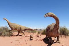 Dinosaur models. The statue, a model dinosaur standing on a red dry sand between the rocks. Artificial dinosaur. Jurassic Park. Models of dinosaurs in the museum stock images