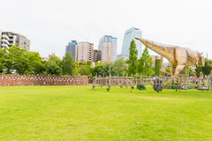 Dinosaur in the park. NAGOYA, JAPAN - JULY 10, 2016:Park located at Noritake Garden Nagoya Japan. Dinosaur in the park stock photography