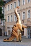 Dinosaur in the picturesque old town Royalty Free Stock Images
