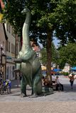 Dinosaur in the picturesque old town Royalty Free Stock Photo