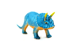 Dinosaur play toy. Blue dinosaur play toy, white background stock photography