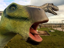 Dinosaur Repilca Head. This photo shows a Dinosaur replica head, these huge fibre glass creatures can be seen at the Winghan Wildlife park in Kent stock photo