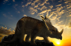 Dinosaur on a rock royalty free illustration