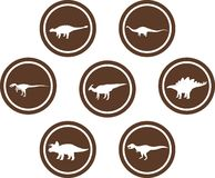 Dinosaur Round Emblem Set Brown. Set of emblems/ badges/ stickers/ icons featuring classic stock dinosaurs. Round button shape Stock Photo