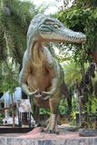 Dinosaur sculpture is in the area of SIRINDHORN MUSEUM. stock photos