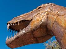 Dinosaur sculpture, huge teeth. Huge dinosaur replica depicts fearsome looking teeth stock photography