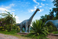 Dinosaur. Sculpture in the park Stock Photos