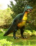 Dinosaur sculpture in the park Stock Image