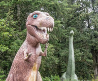 Dinosaur sculptures. Two huge dinosaur replicas at a roadside attraction stock image