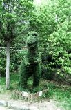 Dinosaur-shaped bush trimmed in the garden stock photography