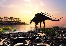 The dinosaur. Dinosaur on the shore of the island Stock Photo