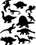Dinosaur Silhouettes. A vector illustration of a dozen dinosaur silhouettes isolated over a white background Royalty Free Stock Image