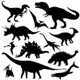 Dinosaur silhouettes set. Vector illustration isolated on white Royalty Free Stock Photos