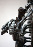 Dinosaur skeleton palm closeup Royalty Free Stock Photos