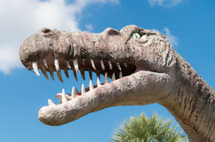 Dinosaur statue in Thailand. On blue sky Stock Images