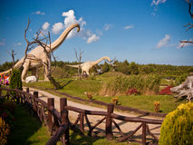 Dinosaur Theme Park, Leba Poland. Large dinosaur statues in grass at Dinosaurs Theme Park in Leba, Poland on sunny day Royalty Free Stock Image