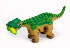 Dinosaur toy. Is eating a leaf Stock Photo