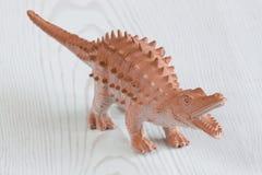 Dinosaur. Toy dinosaur figurine on the white background Stock Image