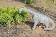 Dinosaur. A toy dinosaur in the garden Stock Photos