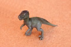 Dinosaur toy. Isolated on brown background Royalty Free Stock Photos