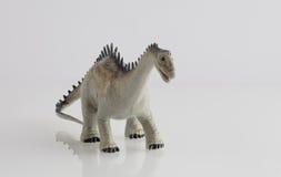 Dinosaur toy isolated on white Stock Photo