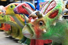 Dinosaur Toys Triceratops. Several Dinosaur Toys with Triceratops at front Stock Photos