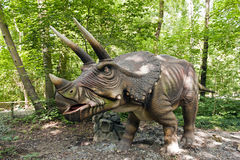 Dinosaur - Triceratops. Close-up of the dinosaur (Triceratops) in the forest Stock Image