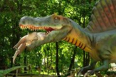 Dinosaur trzyma zęby w dziecku Zdjęcia Stock