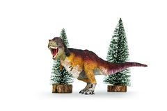 Dinosaur Tyrannosaurus rex feathered covered. Dinosaur Tyrannosaurus rex  t-rex  feathered covered is threaten to roar and Tree pine snow forest model. isolated Royalty Free Stock Photography