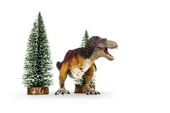 Dinosaur Tyrannosaurus rex feathered covered. Dinosaur Tyrannosaurus rex  t-rex  feathered covered is threaten to roar and Tree pine snow forest model. isolated Royalty Free Stock Photos
