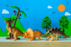 Dinosaur vegetarian on wild models background. Closeup Stock Images