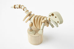 Dinosaur wooden articulated toy isolated on white. Royalty Free Stock Image