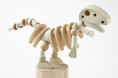 Dinosaur wooden articulated toy isolated on white. Royalty Free Stock Photos