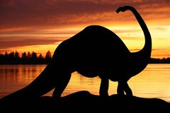 Dinosaur world illustration. Dinosaur on a red sunrise background illustration royalty free illustration