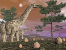 Dinosauri del Argentinosaurus - 3D rendono Immagine Stock