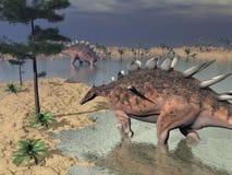 Dinosauri del Kentrosaurus nel deserto - 3D rendono Fotografia Stock