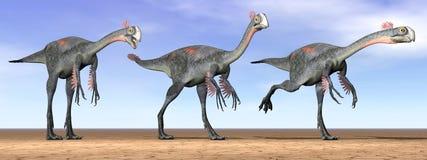 Dinosauri di Gigantoraptor nel deserto - 3D rendono Immagini Stock Libere da Diritti