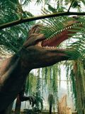 dinosaurie i trädgården arkivfoton