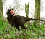 Dinosaurie Ornitholestes i träskskog arkivfoto
