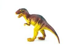 Dinosaurieleksakställning som isoleras på på vit Fotografering för Bildbyråer