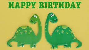 Dinosaurier auf gelbem Hintergrund lizenzfreie stockfotografie
