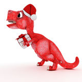 Dinosaurio amistoso de la historieta con la caja de la Navidad del regalo Fotografía de archivo
