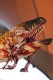 Dinosaurio que come la carne Imagenes de archivo