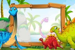 Dinosaurios alrededor del marco de madera Imagen de archivo libre de regalías