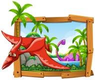 Dinosaurios en marco de madera Foto de archivo libre de regalías
